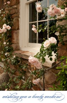 Such delicate blooms highlighted against the rough stone! | post June 1, 2012 | Victoria Magazine #pink #roses #flowers #garden