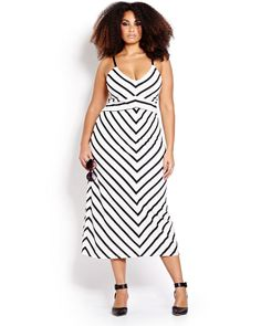 Long luxe maxi dress in textured stripe motif is the perfect vacation chic piece for effortless style wherever you wear it. Plus size, scoop neck, adjustable straps, fully lined. 40 inch length. Ultra chic, ultra flattering!
