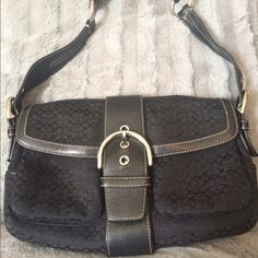 Coach signature C's black bag Coach signature C's black bag. wear on bottom as shown on pictures. Snap closure. Two outside pockets . One inside zipper pocket. Comes with dust bag Coach Bags