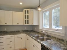 Corner #cabinet details and light finishes in this new home kitchen. #newhome #customkitchen