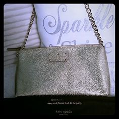 Kate Spade heavenly gold pursie purse Sparkle and shine in a classy way. This purse is authentic and comes with a dust bag. I wish I could keep it forever but this little darling is looking for a new home. kate spade Bags