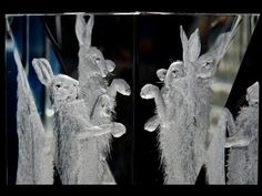 Follow the story of the hand engraving of 2 hares having a scuffle on an optical crystal block by Lesley Pyke - glass engraver