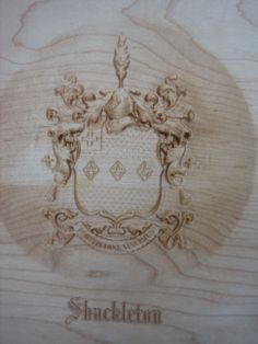"""""""Fortudine Vicimus - By Endurance We Conquer."""" The Shackleton Crest carved onto Maple."""
