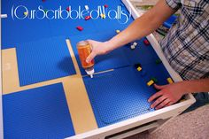 Our Scribbled Walls: DIY Lego (&Train) Table.  Our insert flips over, maybe something on each side?