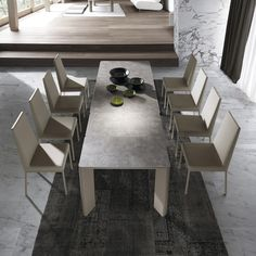 Extendable dining table with ceramic top. Modern design with rounded corners. All ceramic tops are resistant to scratching, heat and sunlight . Available in a wide range of sizes and colours. Compact Furniture, Cool Furniture, Furniture Design, Glass Top Dining Table, Dining Table Design, Dining Tables, Outdoor Dining, Dining Room, Elegant Dining