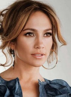 Jennifer Lopez looking pretty with her hair up and a pair of hoop earrings!