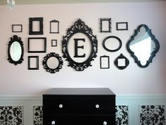 empty frames.//Just did this above the girls beds with frames from the dollar store, spray painted with the colors from their bedspreads and center round silver tray nailed to the wall with thier initial in the center. It looks AWSOME!!!