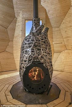 The structure is heated via a heart-shaped wood stove...