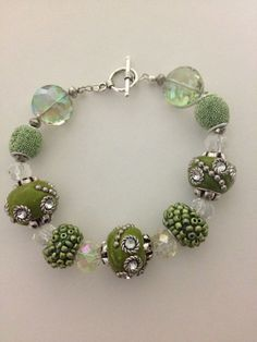 Green beadwork bracelet handmade with crystals and toggle- features jesse james beads on Etsy, $20.00