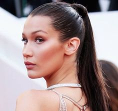 Cannes Film Festival 2016 :Bella Hadid stole the show with a sleek high ponytail, wrapped tightly at the tie with her own hair.