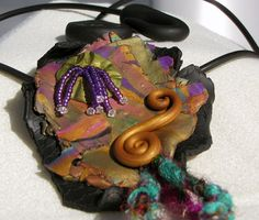 Shield Necklace  Polymer clay, crystal, and beads  Inspired by Christie Friesen - Debbie Martin