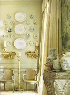 love how they plates are arranged around the sconces