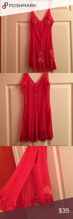 Victoria's Secret silk slip dress / lingerie Delicate pink silk negligee slip with lace detail. Cutouts on both sides with adjustable ties. Adjustable straps. Lace flowers on breasts and bottom of nightie. Size small. Never worn. (Has a matching thong panty I think I wore, but it's washed. Message me if you think you'd also like the panty or to see pics of it) Victoria's Secret Intimates & Sleepwear Chemises & Slips