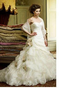 Romance woven into fabric.....new Ian Stuart gown.     http://www.ianstuart-bride.com/docs/KQ_Constantine.html