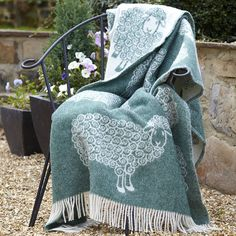 Curly Lamb Wool Blanket  by The Wool Room Would welcome this in my home.  Isn't it darling?