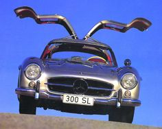 Few cars can compete with the Mercedes-Benz 300 SL. The distinctive gull-wing doors, the dynamic styling, and the classic Mercedes emblem all combine for a Mercedes Benz 300, Classic Mercedes, Steyr, Maybach, Cars Motorcycles, Cool Cars, Dream Cars, Classic Cars, Cool Stuff