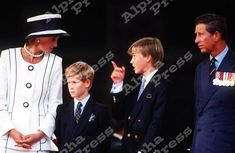 August 19, 1995: Prince Charles, Princess Diana with Prince William and Prince Harry attend the commemoration of VJ Day at Buckingham Palace, London.