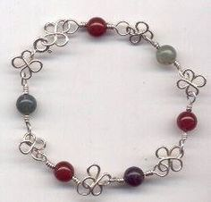 DIY Bijoux  Wire flower and gemstone bead bracelet. Great project for beginners. #wire #jewe