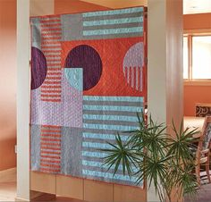 Heather Black was inspired by geometric designs and bold, modern colors. This pattern uses oversized Drunkard's Path blocks for a bed quilt 60