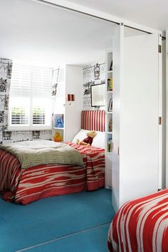Vintage Trains wallpaper is b/w cool and also sliding room divider for privacy is a good idea.
