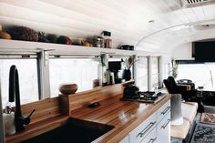 Beautiful modern diy skoolie bus layout. I love the kitchen design. It has so much storage and organization. The bathroom also has a great layout and the blog has shown me plenty of tips and tricks for building my own camper adventure vehicle! Makes me want to #vanlife Camper Interior Design, Bus Interior, Interior Doors, London Bus, Bus Living, Tiny Living, School Bus Conversion, Modern Kitchen Interiors, Bus House