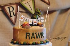 RAWR cake for a Dinosaur Party - love the paper banner.