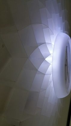 Lampshade design integrated into a clock. Lights up and gives a mood light effect.