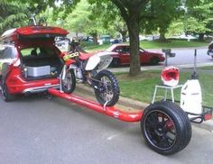 Single tube bike trailer      hmm interesting lightweight    I'd like to see the hitch