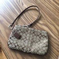 Lowest!! Authentic Coach Wrislet Awesome condition 100% authentic Coach wrislet. No signs of wear :) like new! MAKE AN OFFER, I can't say yes if you don't ask  Coach Bags Clutches & Wristlets
