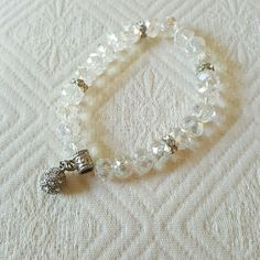 Bracelet Set Just right for a pop of color or to add a little BLING to your prom dress, bridesmaids gown or even your wedding gown!    I can sell individually if you'd like, just let me know.   There is one pearl bracelet, two smoke colored bracelets, one Cobalt blue and one crystal. Jewelry Bracelets