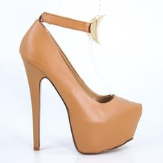 This daring heel stand a towering 6.25 inches, with a 2.25 inch platform. Featuring a metal plate attached to the ankle strap (closes with Velcro), this heel demands respect and gets it. Not for the f