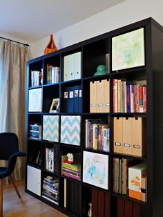 New twist on the Ikea Expedit, 12x12 Painted Canvases on hooks to conceal items (source:Dans le Townhouse) |Home Offices: Storage Without Clutter | Utah Style & Design