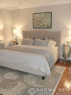 Soft grays and mirrored night stands with pretty white linens. The rug ties it all together. Very peaceful bedroom.