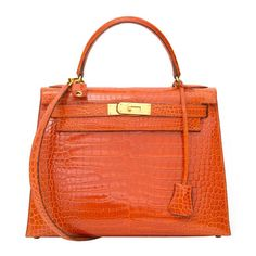 For Sale on - Unseen beauty! This Hermès Kelly bag in precious crocodile Porosus is dyed in one of Hermès' most stunning colors, 'Rouge Agathe'. It is a deep burnt orange Hermes Kelly Bag, Hermes Bags, Hermes Handbags, Black Handbags, Fashion Handbags, Tote Handbags, Purses And Handbags, Leather Handbags, Fabric Handbags