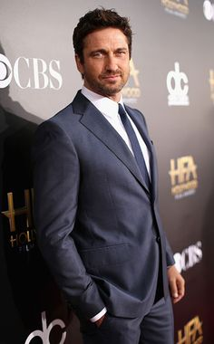 Gerard Butler, SWOOOOOOOOON..... Rugged, manly, handsome, those eyes, the accent, that wicked crooked smile......if he were in front of me I would melt into the floor in 2 seconds