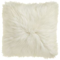 shear glam.  The Icelandic Sheepskin Cushionwas designed exclusively for CB2 in collaboration with Kravitz Design by Lenny Kravitz.  Each piece is inspired by Lenny's eclectic global lifestyle and the furnishings from his homes in Paris, Brazil and the Bahamas.  A collection that turns up the volume, the '70s-inspired designs capture the sleek glam of New York club culture and the natural ease of the California music scene.