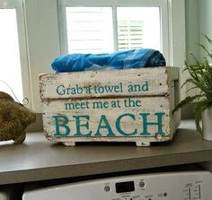Fun storage solution for towels. Old crate makeover with stencils: http://www.completely-coastal.com/2014/10/beach-makeovers-painted-words-sayings.html