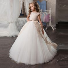 Find designer and fancy communion dresses and gowns for special occasions where you want to dazzle your girl. Our unique communion dresses include beauty pageant dresses, veil, and many more. Beauty Pageant Dresses, Girls Pageant Dresses, Gowns For Girls, Wedding Dresses For Girls, Pageant Gowns, Bride Dresses, Wedding Girl, Tulle Wedding, Gown Wedding
