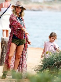 Chic: Elsa later draped a gorgeous floral kimono over her look, displaying her chic beach ...