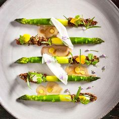"""Asparagus with quinoa, lemon vinaigrette, and lardo by chef Daniel Humm of The NoMad from NY #TheArtOfPlating"""
