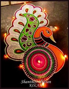 We have included beautiful diwali rangoli designs from shanthi's gallery. It's believed that rangoli designs started many centuries ago. Some refrences of rangoli designs are also available in our Rangoli Designs Peacock, Indian Rangoli Designs, Rangoli Designs Latest, Colorful Rangoli Designs, Easy Rangoli Designs Diwali, Simple Rangoli Designs Images, Rangoli Ideas, Beautiful Rangoli Designs, Rangoli Colours