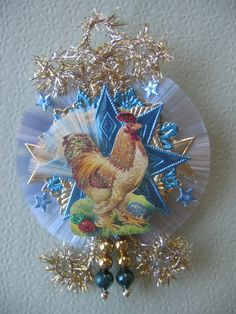 This is a colorful German scrap rooster with Easter eggs. He has a spun glass tail and has been given extra sparkle with glitter. He is