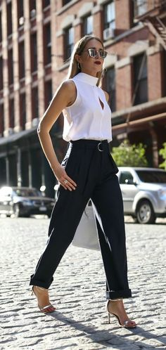 Mock Neck Blouse + Wide Leg Trousers // Ivory mock neck keyhole blouse, navy pleated wide leg trousers, silver ankle strap sandals, white handbag, mirrored sunglasses {Frame, Banana Republic, workwear, creative office style}