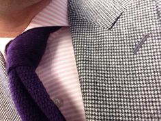 Houndstooth sport coat, pink horizontal striped shirt, purple knit tie