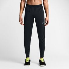 7790ce1b4db6 Nike Dri-Fit Track Pant-A tapered fit. These pants have room through the  thigh and get tighter from the knee down for a fit that offers freedom of  movement.