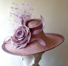 Coutoure Hats: Alicia-Sweeping brim with indent crown in parisisal trimmed with large silk flower and feathers-Heather and Orchid--made in England