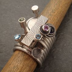11Stacking Rings | Chuck Domitrovich. All the rings are sterling silver and the stones include Swiss blue topaz, chrome diopside, iolite, amethyst, and London blue topaz