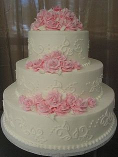 My Photo Album Wedding Cakes Photos on WeddingWire. I would have the pink flowers follow around the cake.