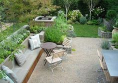 Love the benches and the pea stone. Ad a few colorful potted plants and I'd be very happy here with a vodka tonic!