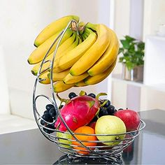 * Fruit Basket With Banana Holder - 14.76 inches tall*. Available on amazon This fruit basket with banana holder is sure to draw attention due to its elegant design.  Unique hook lets you hang and prevent bruises on bananas and grapes!   .It wont scratch the counter tops and rests on ball shaped feet to protect table tops.  http://superurl2.com/4554bf24dd9fd46